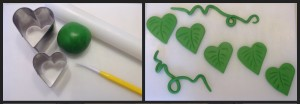 Use a heart-shaped cutter to make green icing leaves