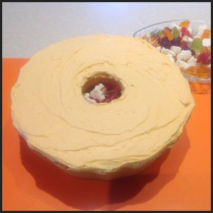 Filling the hollow centre of the cake with sweets