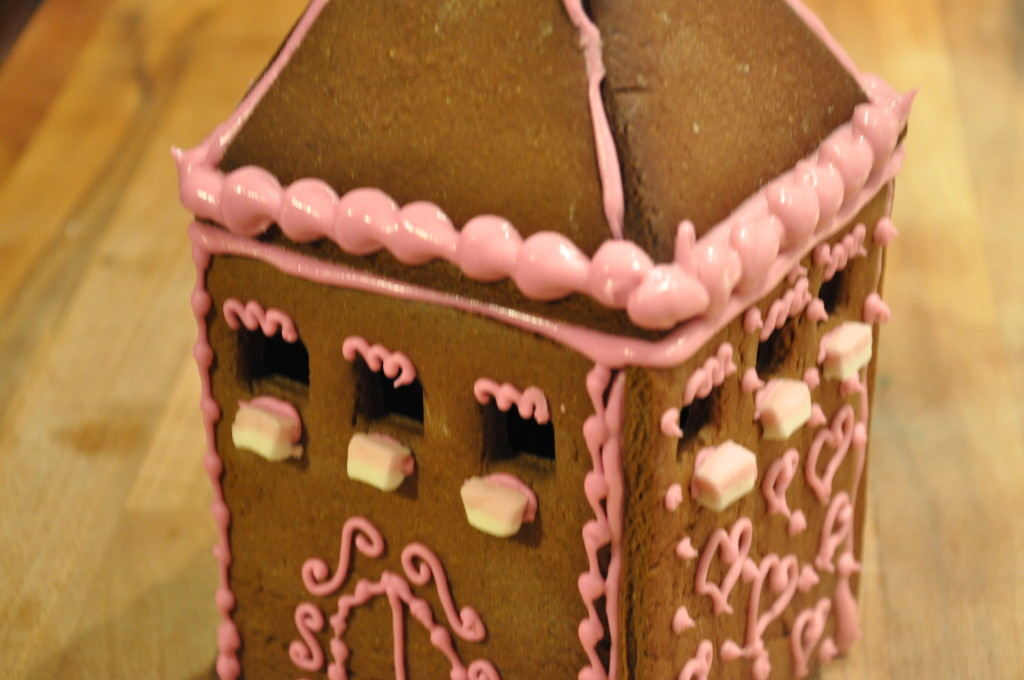 Triangular gingerbread pieces are used to make the turrets of the castle