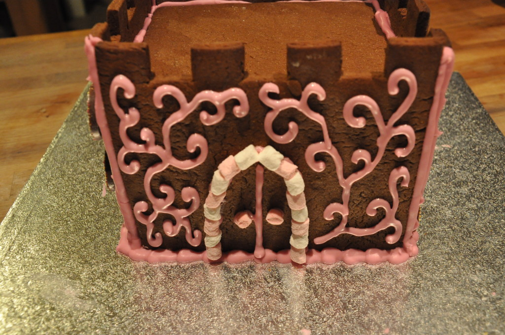 Use marshmallows and piped icing to create a girly gingerbread castle