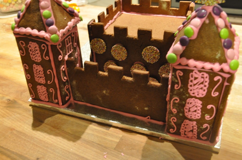 Putting the towers and fortifications of the gingerbread castle together