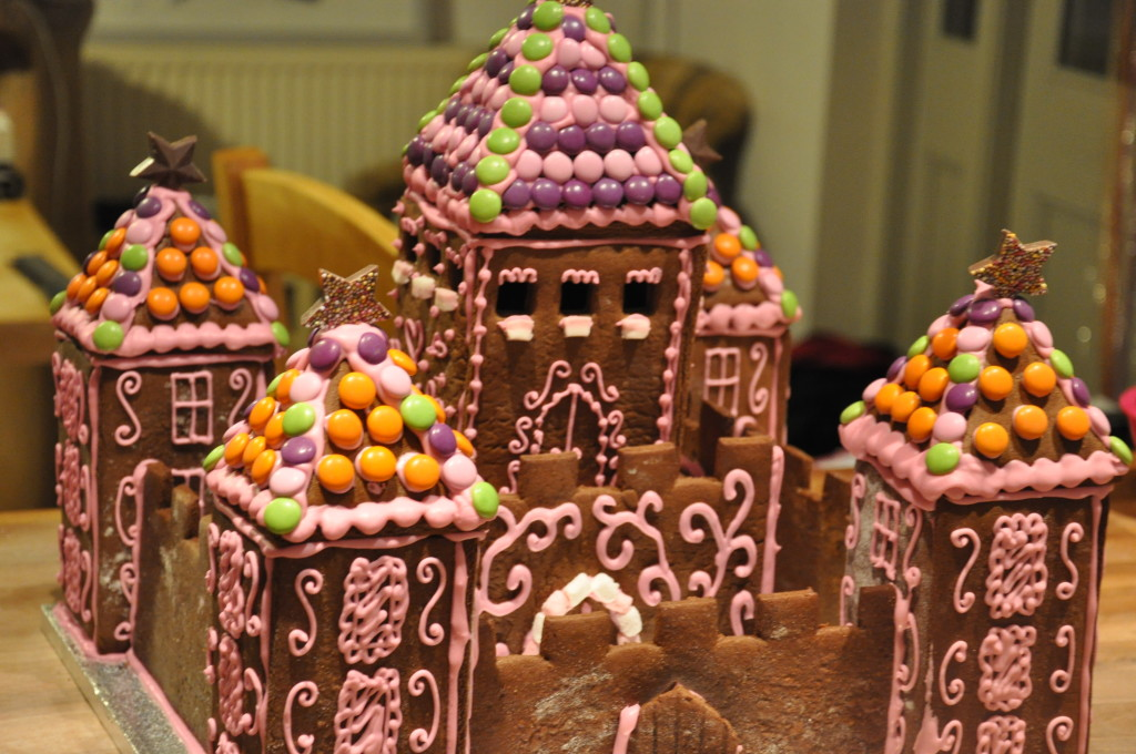 Decorating the almost completed gingerbread castle