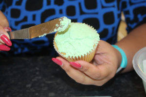 Applying Buttercream To The Cupcake