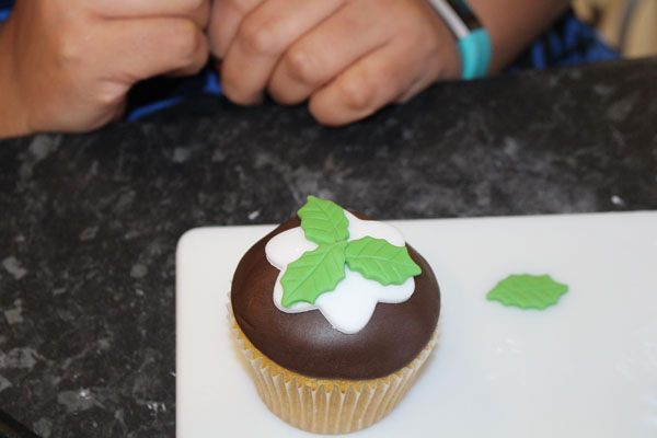 Applying The Leaves To The Top Of The Cupcake