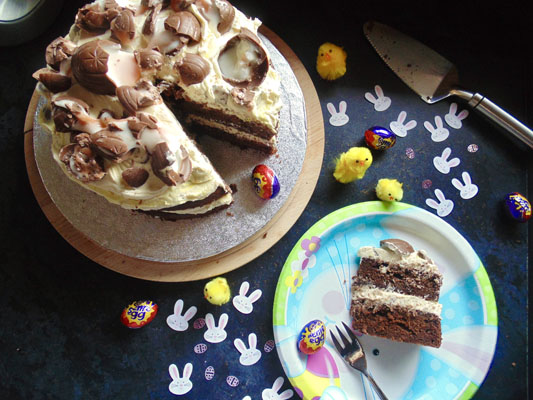 Slicing and serving the Smashed Cream Egg Cake