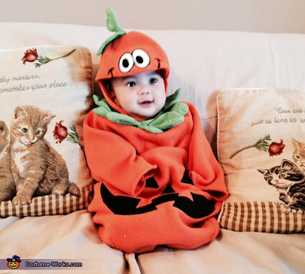 Baby wearing a beautiful Halloween pumpkin outfit