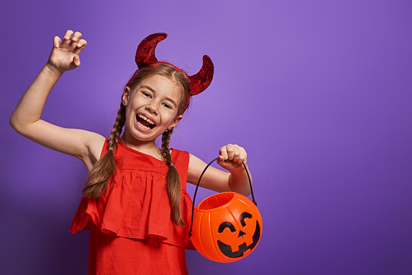 Girl wearing a devil Halloween costume