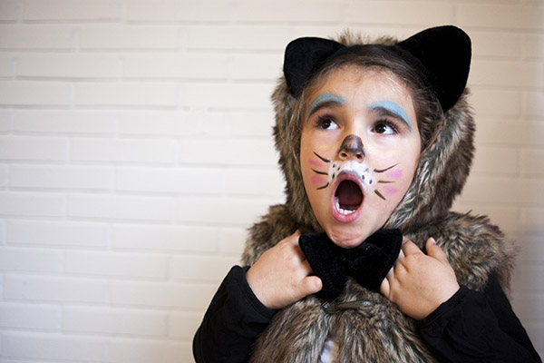 Girl with a cat costume in Halloween
