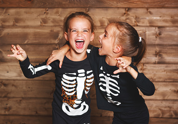 Girls wearing Skeleton Halloween Costumes