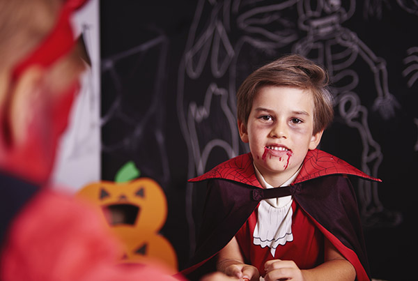 Portrait of boy dressed up as halloween vampire